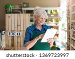shop assistant with digital... | Shutterstock . vector #1369723997