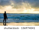 Girl Silhouette On Beach At...