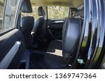 leather black seats in the car... | Shutterstock . vector #1369747364