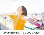 beautiful young woman smiling...   Shutterstock . vector #1369787204