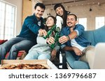good friends at home party.... | Shutterstock . vector #1369796687