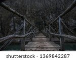 Old Wooden Bridge Covered In Mud