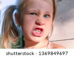little girl with crooked teeth...   Shutterstock . vector #1369849697