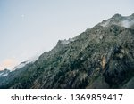 ghostly giant rocks with trees... | Shutterstock . vector #1369859417
