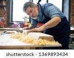 mature handsome joiner work in... | Shutterstock . vector #1369893434
