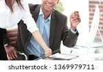 business team in the workplace... | Shutterstock . vector #1369979711