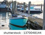 Small Blue Boat On The Jetty...