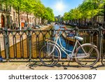 old bicycle on the bridge in... | Shutterstock . vector #1370063087