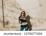 cheerful woman in the street ... | Shutterstock . vector #1370077304