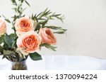 peach roses and eucalyptus in a ... | Shutterstock . vector #1370094224