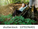 young woman resting at the base ... | Shutterstock . vector #1370196401