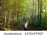 young woman taking a walk in... | Shutterstock . vector #1370197907