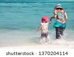 young asian mother and cute... | Shutterstock . vector #1370204114
