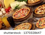 variety of pizzas on a rustic... | Shutterstock . vector #1370328647