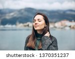 young beautiful girl enjoys...   Shutterstock . vector #1370351237