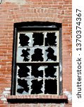 broken window at the brickworks ... | Shutterstock . vector #1370374367