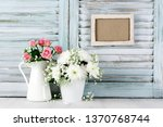 flowers bouquets on wood table... | Shutterstock . vector #1370768744