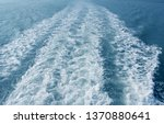 frothy trail behind the boat on ... | Shutterstock . vector #1370880641