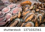 fresh mussels and scallops on... | Shutterstock . vector #1371032561