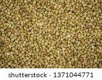 croup green buckwheat on a dark ... | Shutterstock . vector #1371044771