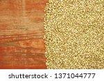 croup green buckwheat on a dark ... | Shutterstock . vector #1371044777