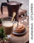 hot coffee and pastries on a... | Shutterstock . vector #1371249854