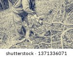 worker using chain saw and... | Shutterstock . vector #1371336071