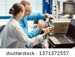 team of electronic engineers...   Shutterstock . vector #1371372557