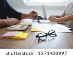two adult people working... | Shutterstock . vector #1371403997