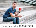 caucasian man with mobile phone ... | Shutterstock . vector #1371462494