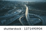 Night Aerial Urban Traffic Road System. Busy Downtown Route Development City Highway Junction Overview. Cityscape Car Motion Transport. Dark Blue Cinematic Filter. Concept Drone Flight Shot