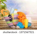 bag   flip flops on a tropical... | Shutterstock . vector #1371567521