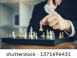 businessman playing chess game...   Shutterstock . vector #1371696431