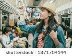 young female asian traveler... | Shutterstock . vector #1371704144