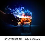 image of two glasses of burning ... | Shutterstock . vector #137180129
