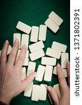 female hands mixing domino...   Shutterstock . vector #1371802391