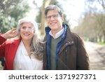 beautiful couple walking... | Shutterstock . vector #1371927371