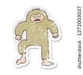 Stock photo distressed sticker of a cartoon bigfoot 1372003037