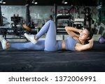 asian young woman exercising in ... | Shutterstock . vector #1372006991