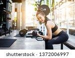 sporty beautiful woman... | Shutterstock . vector #1372006997