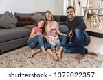 portrait of happy family... | Shutterstock . vector #1372022357