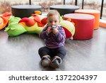 cute fair baby girl sitting on... | Shutterstock . vector #1372204397