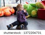 cute fair baby girl sitting in... | Shutterstock . vector #1372206731