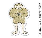 Stock photo distressed sticker of a cartoon bigfoot 1372210607