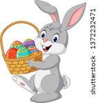 Cartoon Rabbit Holding An...