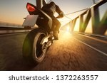 motorcycle on a bridge | Shutterstock . vector #1372263557