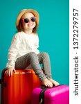 little smiling girl in straw... | Shutterstock . vector #1372279757