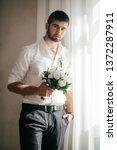 beautiful young man    Shutterstock . vector #1372287911