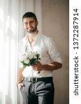 beautiful young man    Shutterstock . vector #1372287914