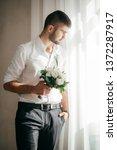beautiful young man    Shutterstock . vector #1372287917